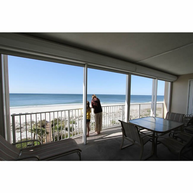 Mom and daughter enjoy the beautiful view at the condo in Orange Beach condo! www.CondoRentalOrangeBeach.com beach vacation orangebeach gulfshores