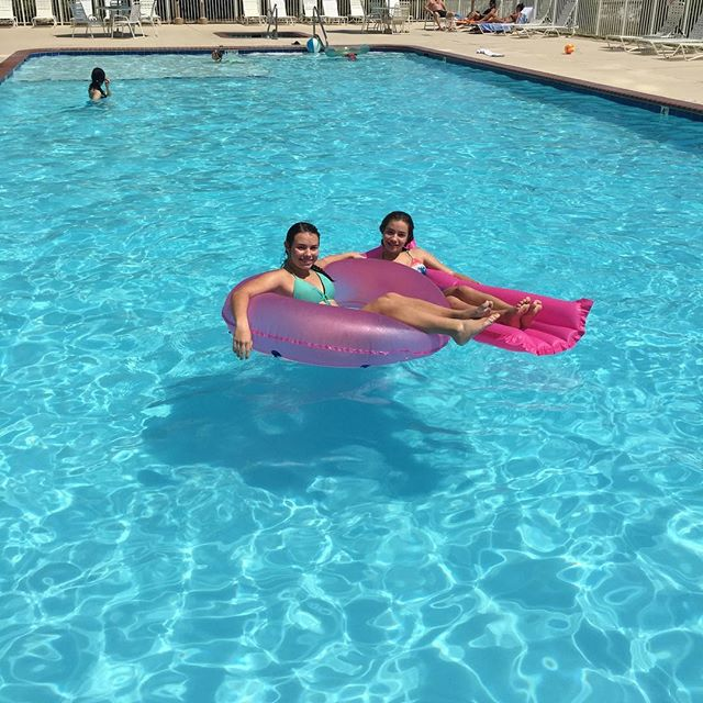 Soaking up rays and relaxing! We love this big pool.