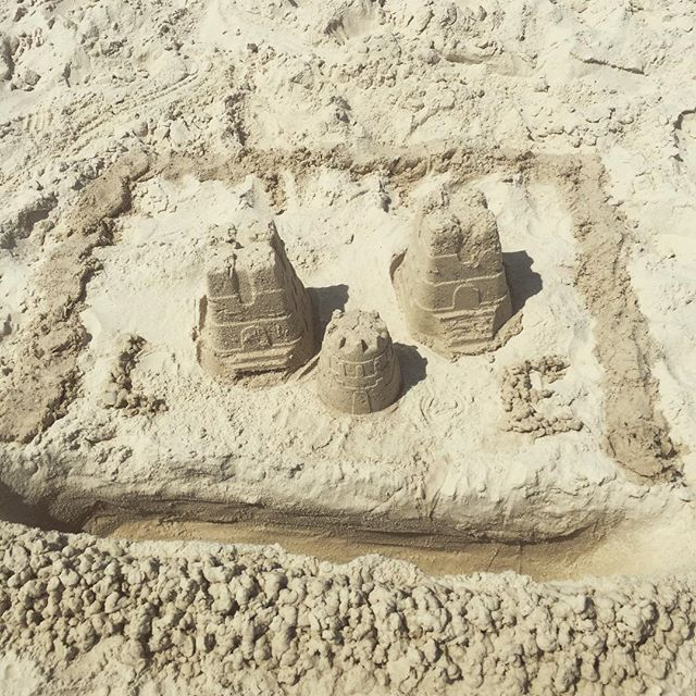 Making sand castles at our favorite beach - come build yours too! #orangebeach #orangebeachcondorentals #familyvacation #sandcastles