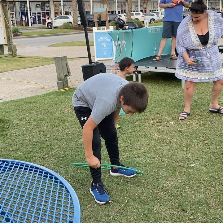 Having great family time at the Wharf in Orange Beach- every Wednesday is Family Day.  They had music, bubbles and Hulu hoops for the kids to play with.  There is an arcade with games and laser tag and also a virtual reality game store. We had a blast!